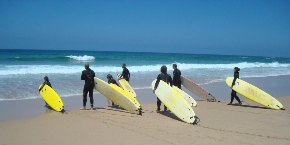 Heading into the surf on the Alentejo coast.