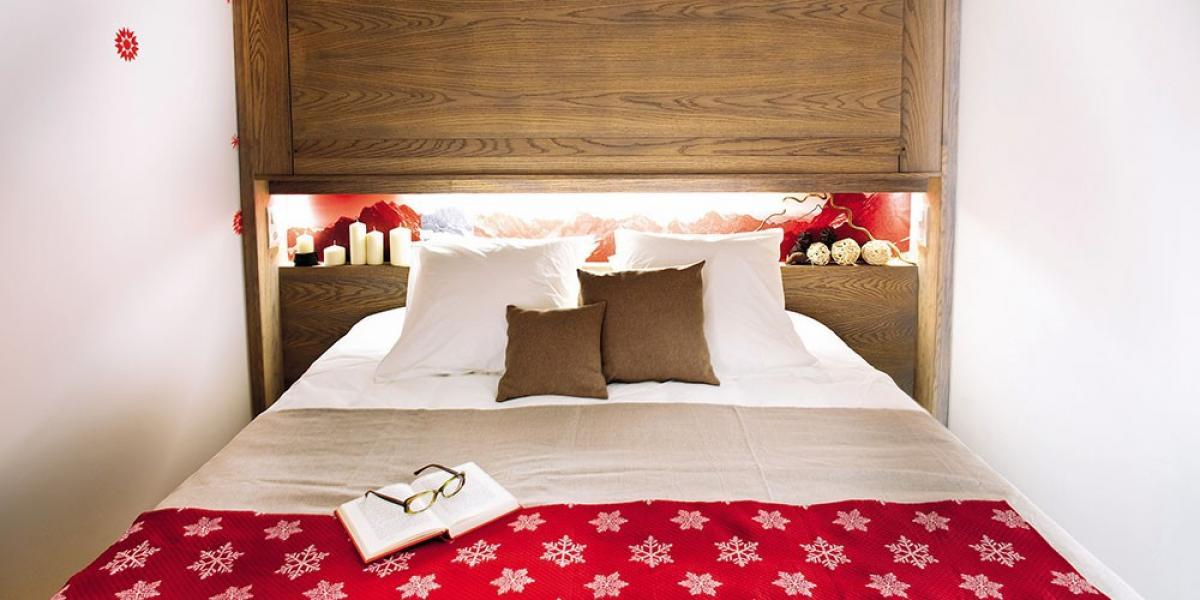 A cosy apartment bedroom at Pierre & Vacances Residence Atria-Crozats.