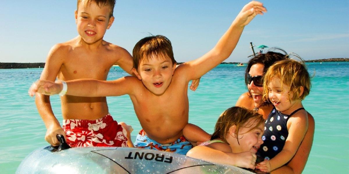 Mum at the beach with kids