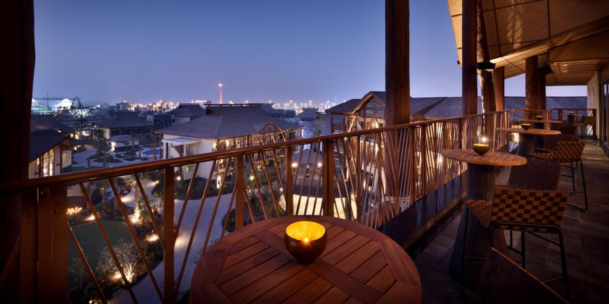 Rootop bar at the Lapita Hotel, with view towards the themepark rides.