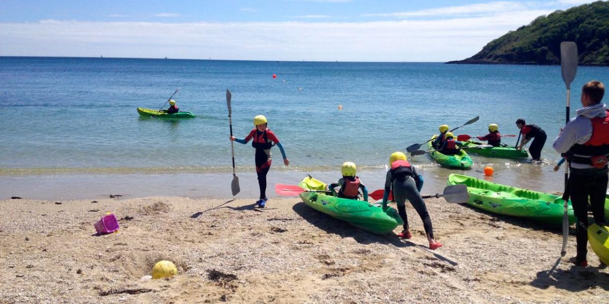 Setting off to explore sea caves from Swanpool Beach, Falmouth.