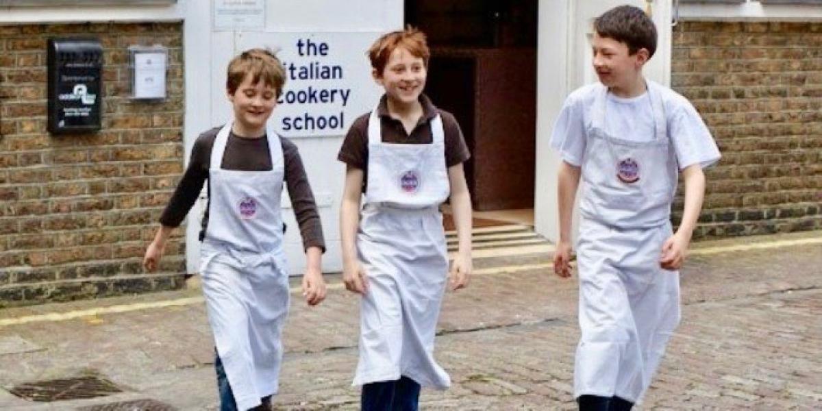 Kids at The Italian Cookery School at Cucina Caldesi, London.