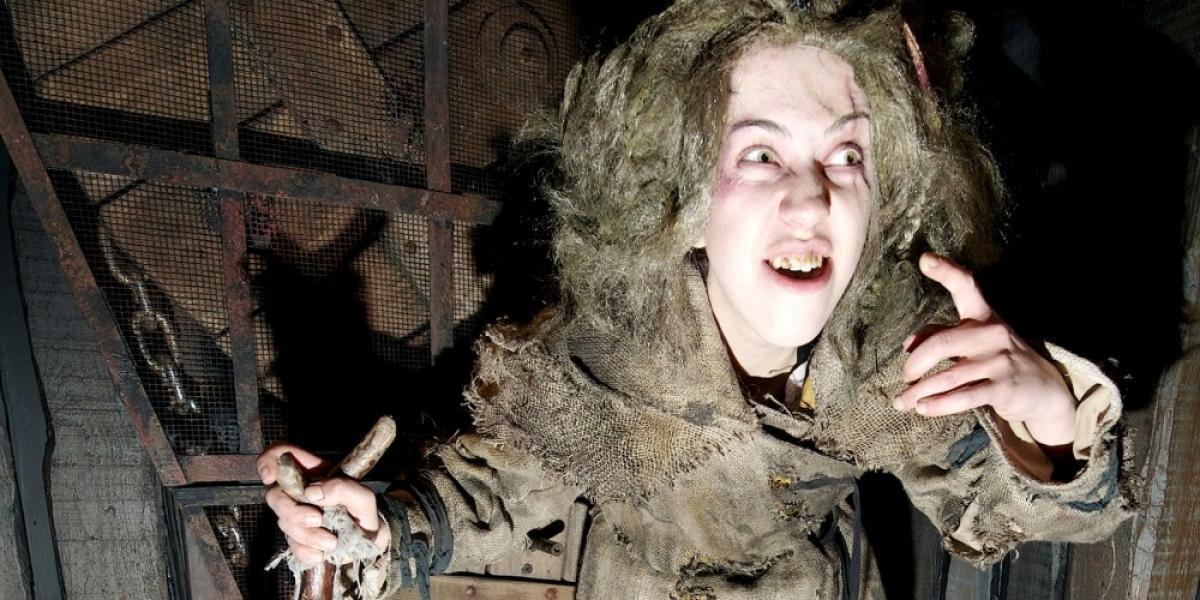A leper welcomes visitors to the London Dungeon.