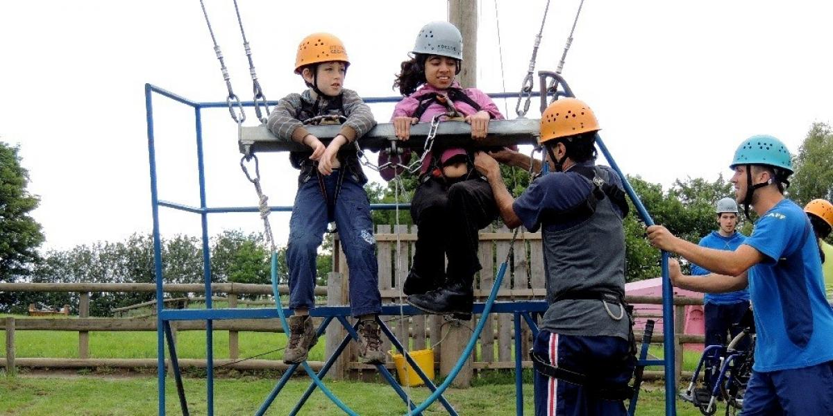 Riana and friend Ethan on the giant swing at PGL Boreatton Park.