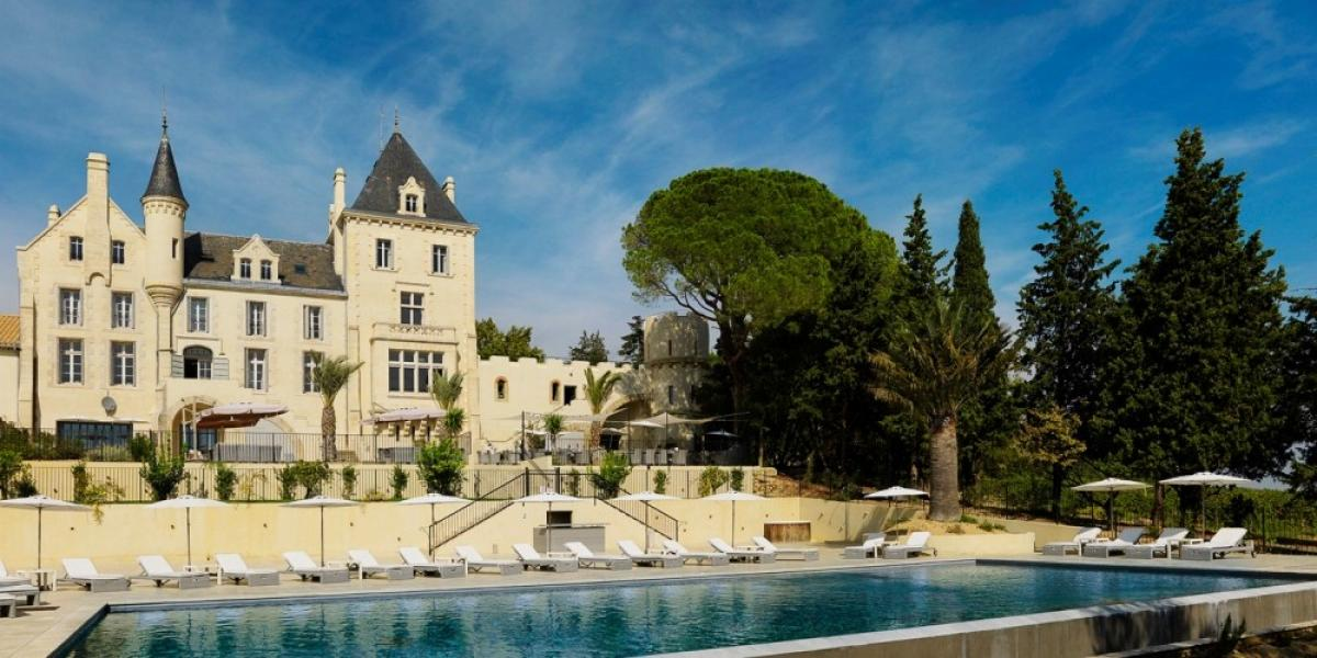 Hotel and pool at Château Les Carrasses.