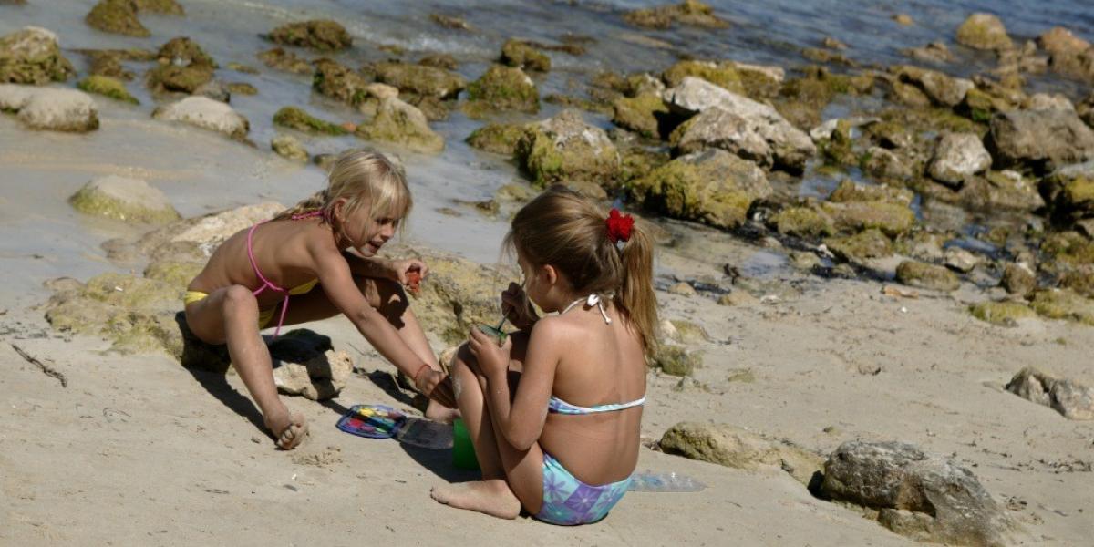 Girls playing on a Mallorcan beach.