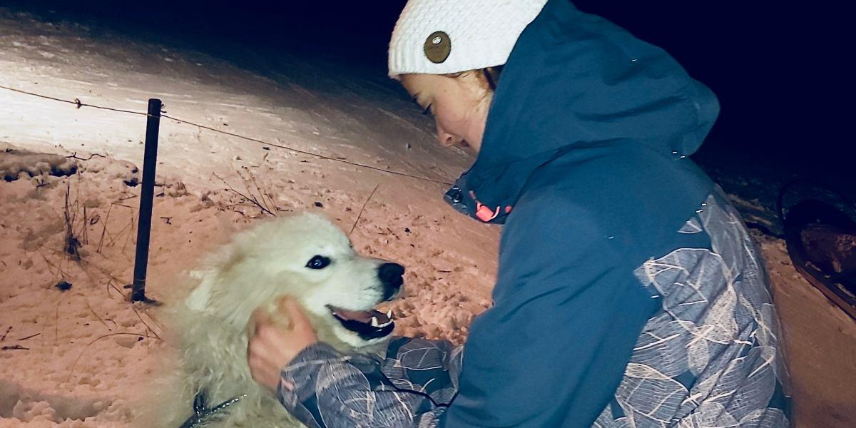 Olivia with a samoyed at the tipi camp