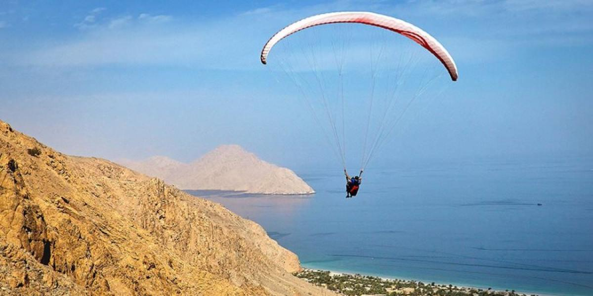 Paragliding over Zighy Bay.
