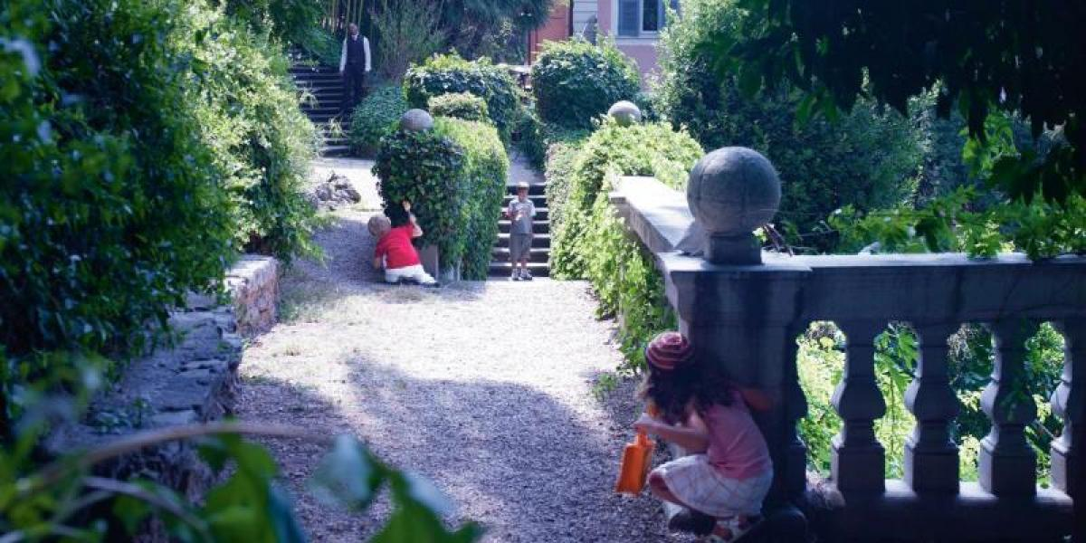 Kids playing in the gardens at Hotel de Russie.