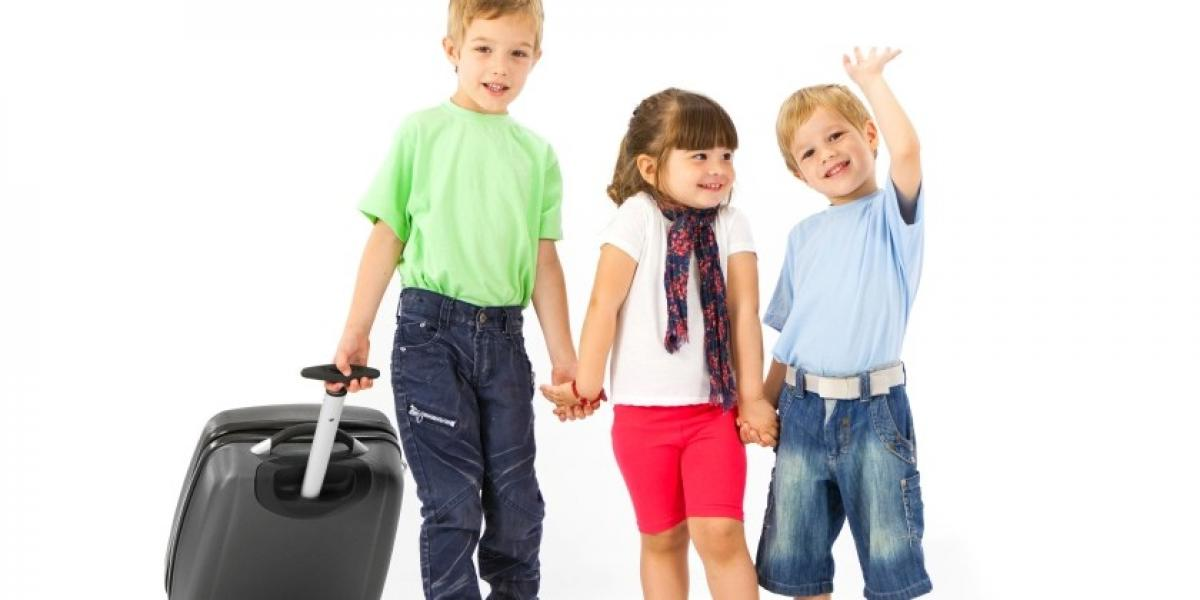 Children with suitcase ready for holiday
