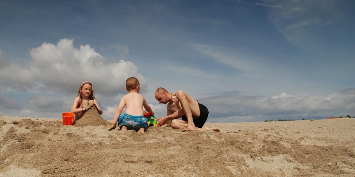 A family building a sandcastle