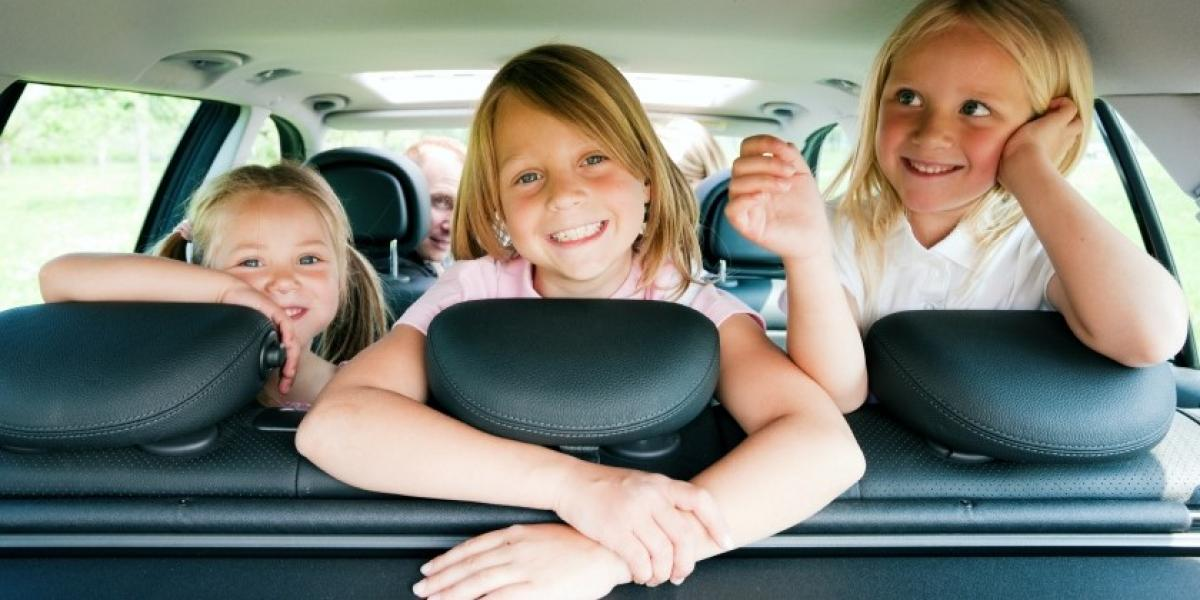 Children getting ready for a car journey