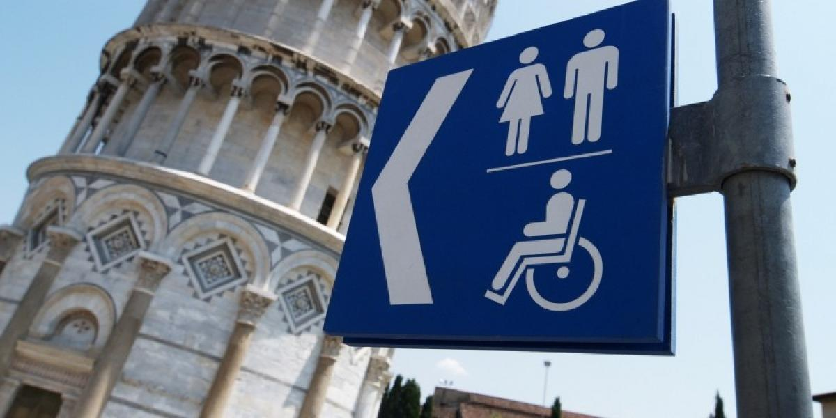 Toilet signs outside the Leaning Tower of Pisa