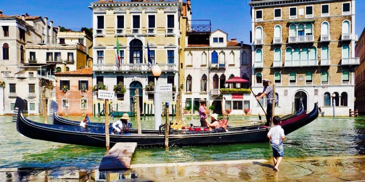 Boarding a gondola in Venice.