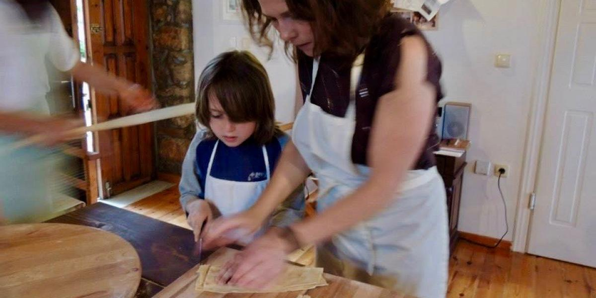 Making fresh Greek pasta at a cookery lesson arranged by the resort.