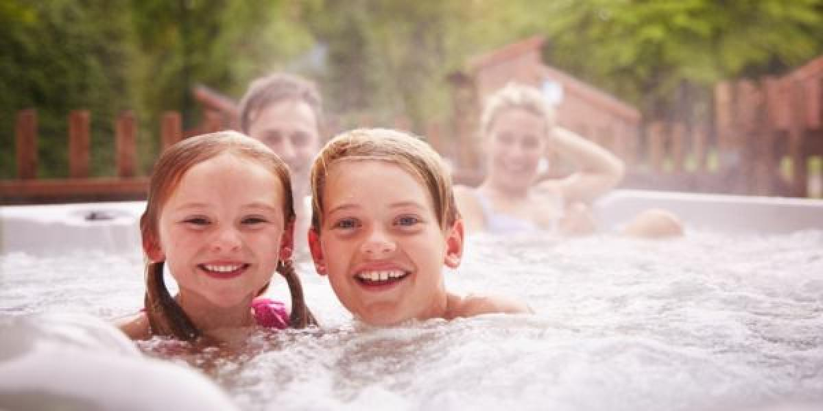 Family relaxing in hot tub in Cropton