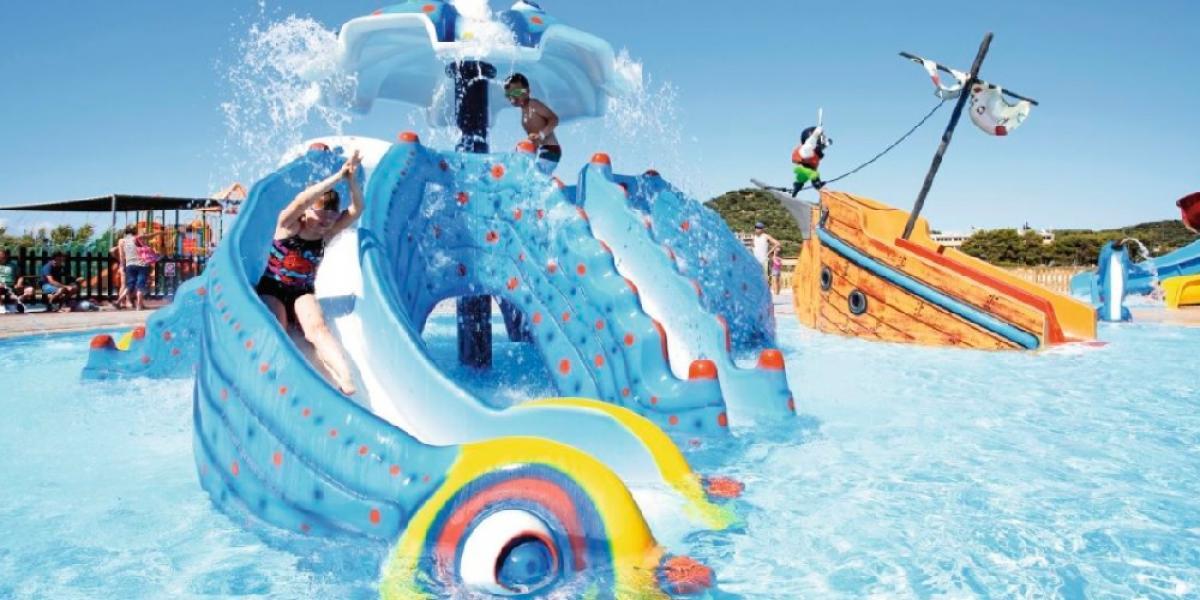 Splash pool fun at Alykanas Beach Village.